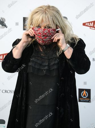 """Helen Lederer attends the World Premiere of the """"Break"""" Drive-In at Brent Cross Shopping Centre in London while wearing a face mask."""