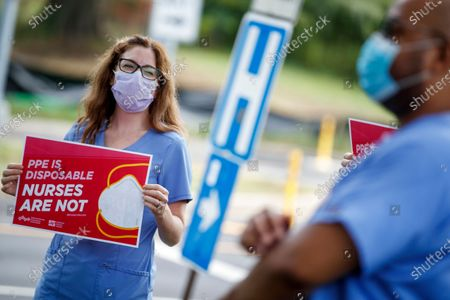 Registered nurse Emily Young (L), with her colleagues, participates in a press conference to demand that optimal PPE be provided to the RNs and that the hospital abandons the decontamination process for N95 respirators at MedStar Washington Hospital Center in Washington, DC, USA, 23 July 2020. There are reports of nurses not being fit-tested for their N95 respirators and the hospital recently announced a pilot program that would have nurses reuse their PPE for an entire week.