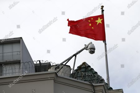 A security camera on top of the Chinese consulate as the Chinese flag flaps in the wind in San Francisco, California, USA, 23 July 2020. The FBI alleges that a biology researcher linked to the Chinese military is taking refuge in the Chinese consulate to avoid getting arrested for visa fraud.