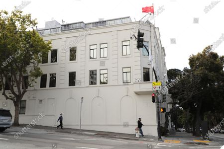 Pedestrians walk along the outside of the Chinese consulate in San Francisco, California, USA, 23 July 2020. The FBI alleges that a biology researcher linked to the Chinese military is taking refuge in the Chinese consulate to avoid getting arrested for visa fraud.