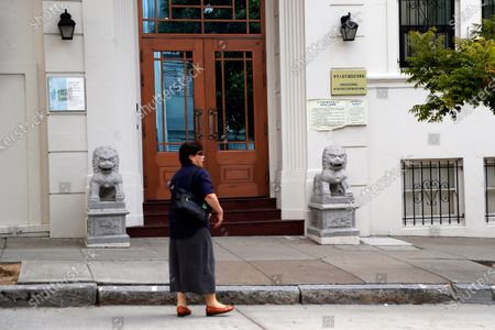 A woman stands outside the entrance of the Chinese consulate in San Francisco, California, USA, 23 July 2020. The FBI alleges that a biology researcher linked to the Chinese military is taking refuge in the Chinese consulate to avoid getting arrested for visa fraud.