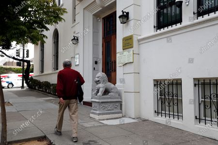 A man walks past an entrance of the Chinese consulate in San Francisco, California, USA, 23 July 2020. The FBI alleges that a biology researcher linked to the Chinese military is taking refuge in the Chinese consulate to avoid getting arrested for visa fraud.