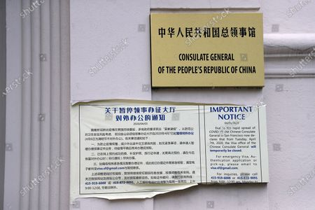 Consulate General of the People's Republic of China sign and a COVID-19 notice for people trying to get a Visa, at an entrance of the Chinese consulate in San Francisco, California, USA, 23 July 2020. The FBI alleges that a biology researcher linked to the Chinese military is taking refuge in the Chinese consulate to avoid getting arrested for visa fraud.