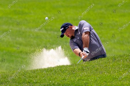 Brendon de Jonge hits from a bunker during the first round of the 3M Open golf tournament in Blaine, Minn