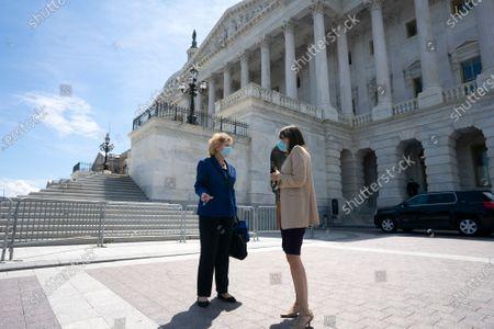 United States Senator Debbie Stabenow (Democrat of Michigan) speaks to United States Senator Maria Cantwell (Democrat of Washington) as they leave following votes at the U.S. Capitol in Washington D.C., U.S.,.