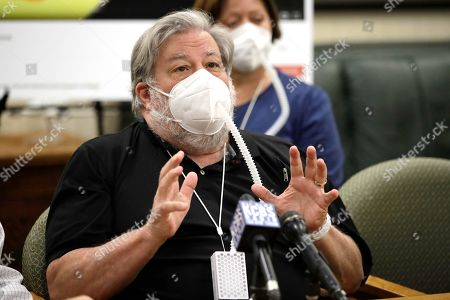 Stock Image of Apple co-founder Steve Wozniak gestures during a zoom media conference, in Burlingame, Calif. Wozniak is joining a legal fight taking aim at the flimsy controls on Google's YouTube video site that have turned him into a unwilling pawn in a scam that has stolen millions of dollars from people around the world