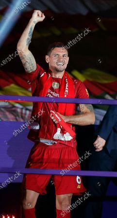 Dejan Lovren of Liverpool receives his premier league medal
