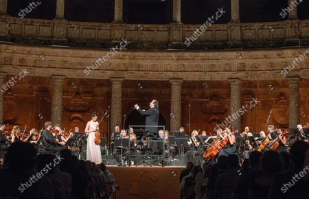 Stock Image of Spanish maestro Juanjo Mena (C) and violinist Maria Duenas (C-L) during the Galician Symphonic Orchestra concert, included in Granada's International Music and Dance Festival in Carlos V Palace, in Granada, Spain 23 July 2020.