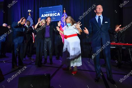 Ralph Reed, from right, Dr. Alveda King, Journey keyboardist Jonathan Cain, and personal pastor to the president, Paula White Cain, and others pray on stage during a Donald Trump campaign event courting devout conservatives by combining praise, prayer and patriotism, in Alpharetta, Ga