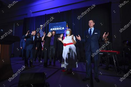 Stock Image of Ralph Reed, from right, Dr. Alveda King, Journey keyboardist Jonathan Cain, personal pastor to the President, Paula White Cain, Bishop Harry Jackson, and others pray on stage during a Donald Trump campaign event courting devout conservatives by combining praise, prayer and patriotism, in Alpharetta, Ga