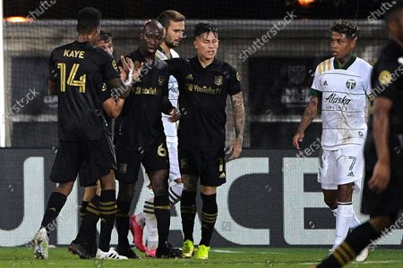 Los Angeles FC forward Bradley Wright-Phillips (66) is congratulated by midfielder Mark-Anthony Kaye (14) and midfielder Brian Rodriguez (17) after scoring a goal as Portland Timbers forward Andy Polo (7) watches during the first half of an MLS soccer match, in Kissimmee, Fla
