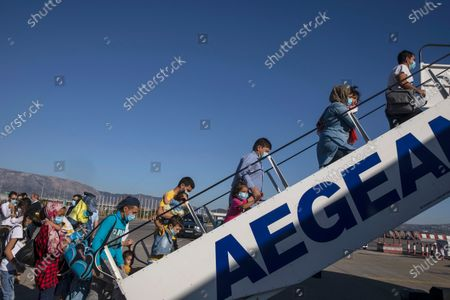 Group of 85 refugee children with health issues boards a plane to Germany, at Athens International Airport, . German Foreign Heiko Maas, on a visit to Athens this week, said his country would follow through in its pledge to assist Greece with the relocation of unaccompanied minors and other children at refugee camps in Greece