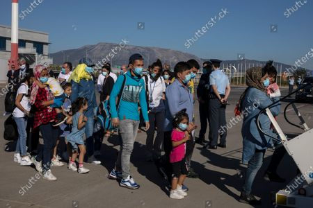 Group of migrant children with health issues board a plane to Germany, at Athens International Airport, . German Foreign Heiko Maas, on a visit to Athens this week, said his country would follow through in its pledge to assist Greece with the relocation of unaccompanied minors and other children at refugee camps in Greece