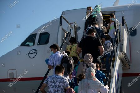 Group of migrant children with health issues board a plane to Germany, at Athens International Airport, on . German Foreign Heiko Maas, on a visit to Athens this week, said his country would follow through in its pledge to assist Greece with the relocation of unaccompanied minors and other children at refugee camps in Greece