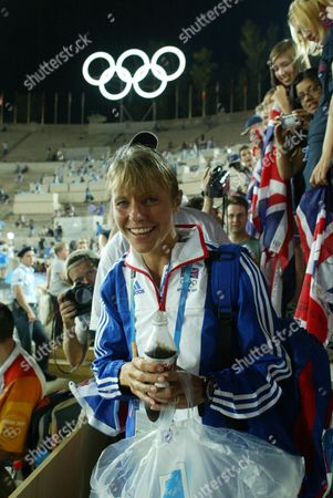 Tracey Morris Gb Runner After Finnishing The Womans Marathon In 2004 Olympic Games In Athens.