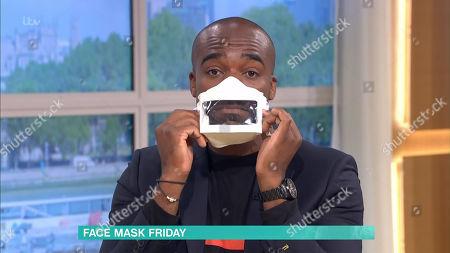 Ore Oduba tries on a face mask
