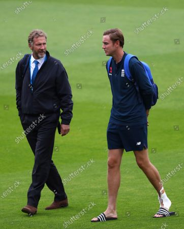 England's Stuart Broad, right, walks with his father and match referee Chris Broad after the first day of the third cricket Test match between England and West Indies at Old Trafford in Manchester, England