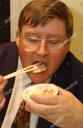 Evening Standard Food Critic Charles Campion Tucks Into Koi Carp Cooked In Ginger And Spring Onion With Singapore Noodles Chinese Broccoli And Plain Boiled Rice At The Fung Shing Restaurant In Chinatown.london