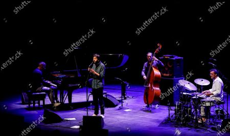 Stock Picture of Salvador Sobral (2-L), the winner of the 2017 Eurovision Song Contest,  performs alongside an instrumental jazz trio made up of a grand piano (L), a double bass (2-R) and drums (R) at the Kursaal Congress Center and Auditorium in San Sebastian, northern Spain, 24 July 2020. The performance was part of the 55th edition of the San Sebastian Jazz Festival (officially titled 'Heineken Jazzaldia'), which runs from 22-26 July.