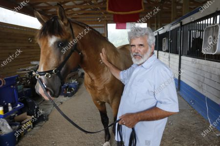 Dr. Robert Malone holds the reigns of his stallion, Jade II Da Sernadinha, on his horse farm, in Madison, Va. Malone serves as a consultant to a Pentagon-funded program that develops medications to protect American troops from biological threats