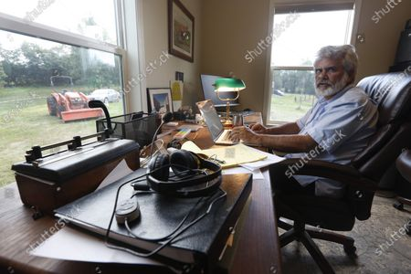 Dr. Robert Malone works in his office on his horse farm, in Madison, Va. Malone serves as a consultant to a Pentagon-funded program that develops medications to protect American troops from biological threats