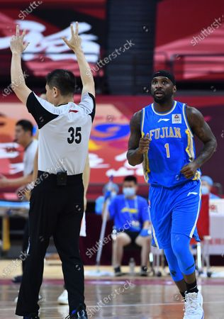 Stock Picture of Ty Lawson (R) of Fujian Sturgeons reacts after scoring during a match between Fujian Sturgeons and Shanghai Sharks at the 2019-2020 Chinese Basketball Association (CBA) league in Qingdao, east China's Shandong Province, July 24, 2020.
