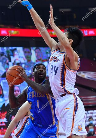 Stock Image of Ty Lawson (L) of Fujian Sturgeons competes during a match between Fujian Sturgeons and Shanghai Sharks at the 2019-2020 Chinese Basketball Association (CBA) league in Qingdao, east China's Shandong Province, July 24, 2020.