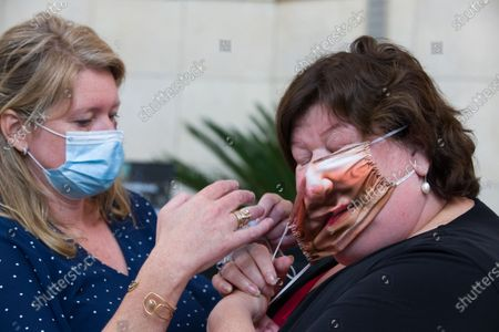 Minister of Health, Social Affairs, Asylum Policy and Migration Maggie De Block pictured wearing a 'Plein Publiek' mouth mask with a picture of her face on it, during the launch of the 'volgderegels' (follow the rules) campaign to fight Covid-19 by Horeca Vlaanderen, representing the hotel, restaurant en cafe sectors, Friday 24 July 2020 in Brussels.