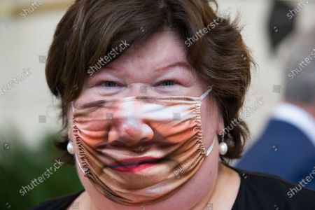 Minister of Health, Social Affairs, Asylum Policy and Migration Maggie De Block poses for the photographer wearing a 'Plein Publiek' mouth mask with a picture of her face on it, after the launch of the 'volgderegels' (follow the rules) campaign to fight Covid-19 by Horeca Vlaanderen, representing the hotel, restaurant en cafe sectors, Friday 24 July 2020 in Brussels.