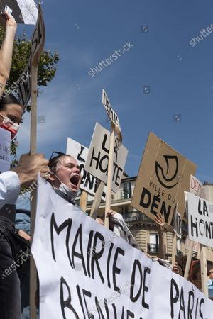 Stock Photo of About thirty people gathered to demand the resignation of the cultural assistant Christophe Girard