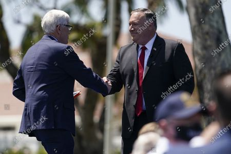 Secretary of State Mike Pompeo, right, shakes hands with Hugh Hewitt, left, president and CEO of the Nixon Foundation, after Pompeo spoke at the Richard Nixon Presidential Library, in Yorba Linda, Calif