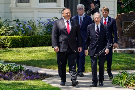 Secretary of State Michael R. Pompeo walks out with former California Governor Pete Wilson before speaking at the Richard Nixon Presidential Library and Museum on Thursday, July 23, 2020 in Yorba Linda, CA. (Kent Nishimura / Los Angeles Times)