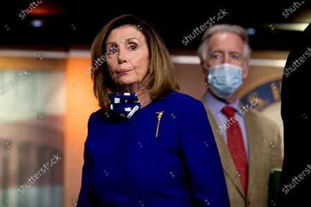House Speaker Nancy Pelosi of Calif., left, accompanied by Rep. Richard Neal, D-Mass., right, listens to a question from a reporter during a news conference on Capitol Hill in Washington, on the extension of federal unemployment benefits