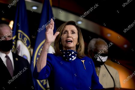 House Speaker Nancy Pelosi of Calif., accompanied by Rep. Dan Kildee, D-Mich., left, and Rep. Danny Davis, D-Ill., right, speaks at a news conference on Capitol Hill in Washington, on the extension of federal unemployment benefits
