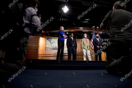 From left, House Speaker Nancy Pelosi of Calif., accompanied by Rep. Dwight Evans, D-Pa., Rep. Richard Neal, D-Mass., and Rep. Dan Kildee, D-Mich., listens to a question from a reporter during a news conference on Capitol Hill in Washington, on the extension of federal unemployment benefits