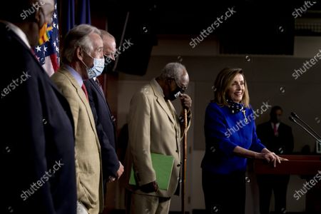 House Speaker Nancy Pelosi of Calif., right, accompanied by from left, Rep. Dwight Evans, D-Pa., Rep. Richard Neal, D-Mass., Rep. Dan Kildee, D-Mich., and Rep. Danny Davis, D-Ill., smile while speaking during a news conference on Capitol Hill in Washington, on the extension of federal unemployment benefits