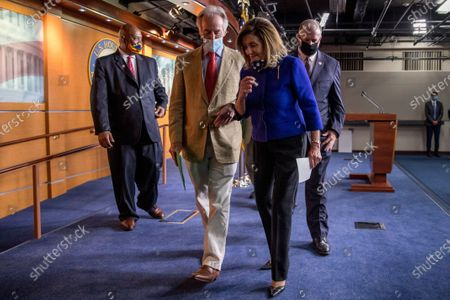From left, Rep. Dwight Evans, D-Pa., Rep. Richard Neal, D-Mass., House Speaker Nancy Pelosi of Calif., and Rep. Dan Kildee, D-Mich., leave a news conference on Capitol Hill in Washington, on the extension of federal unemployment benefits