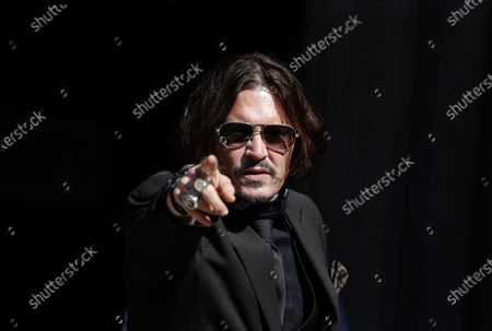 """Actor Johnny Depp arrives at the High Court in London in London, . Depp is suing News Group Newspapers, publisher of The Sun, and the paper's executive editor, Dan Wootton, over an April 2018 article that called him a """"wife-beater."""" Depp denies all allegations"""