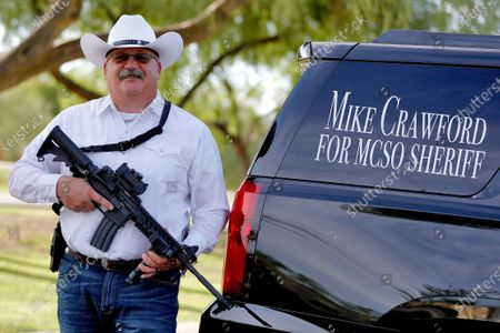 Maricopa County Sheriff candidate Mike Crawford, a Glendale, Ariz. police officer, is shown, in Glendale, Ariz. Crawford is running against former Sheriff Joe Arpaio and Arpaio's former second-in-command, Jerry Sheridan, in the GOP primary