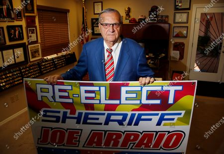 Former Maricopa County Sheriff Joe Arpaio poses for a picture in his office as he is running for the position of Maricopa County Sheriff again, in Fountain Hills, Ariz. He faces his former second-in-command, Jerry Sheridan, in the Aug. 4 Republican primary in what has become his second comeback bid. The 88-year-old lawman was unseated in the 2016 sheriff's race and was trounced in a 2018 U.S. Senate race
