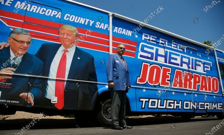 Former Maricopa County Sheriff Joe Arpaio, poses for a photograph in front of his campaign vehicle as he is running for the position of Maricopa County Sheriff again, in Fountain Hills, Ariz. Arpaio is trying to win back the sheriff's post in metro Phoenix that he held for 24 years. He faces his former second-in-command, Jerry Sheridan, in the Aug. 4 Republican primary in what has become his second comeback bid