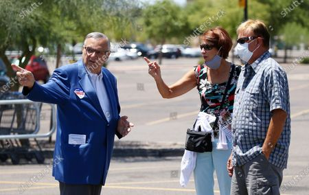 Former Maricopa County Sheriff Joe Arpaio, left, campaigns as he is running for the position of Maricopa County Sheriff again, in Scottsdale, Ariz. He faces his former second-in-command, Jerry Sheridan, in the Aug. 4 Republican primary in what has become his second comeback bid. The 88-year-old lawman was unseated in the 2016 sheriff's race and was trounced in a 2018 U.S. Senate race