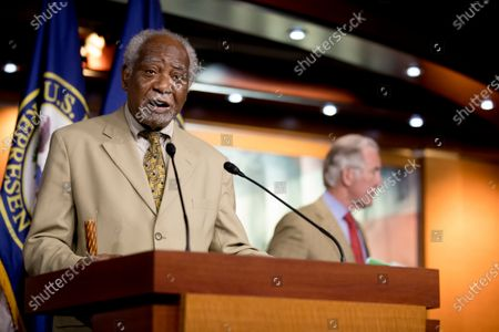 Rep. Danny Davis, D-Ill., left, accompanied Rep. Richard Neal, D-Mass., speaks during a news conference on Capitol Hill in Washington, on the extension of federal unemployment benefits