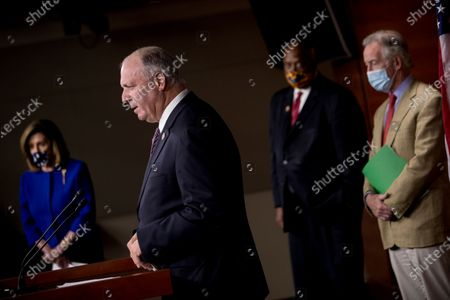 Rep. Dan Kildee, D-Mich., second from left, accompanied by House Speaker Nancy Pelosi of Calif., left, Rep. Dwight Evans, D-Pa., second from right, and Rep. Richard Neal, D-Mass., right, speaks at a news conference on Capitol Hill in Washington, on the extension of federal unemployment benefits