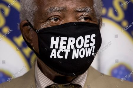 """Rep. Danny Davis, D-Ill., wears a mask that reads """"Heroes Act Now"""" as he appears at a news conference on Capitol Hill in Washington, on the extension of federal unemployment benefits"""