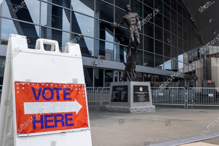 A statue of Atlanta Hawks legend Dominique Wilkins greets constituents participating in Early Voting for an August runoff election at State Farm Arena, home the of the NBAÕs Atlanta Hawks basketball team, in Atlanta, Georgia, USA, 24 July 2020. The new Fulton County early voting location, was opened in an effort to ease long lines at other polling location during a June 2020 election.