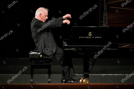 Stock Picture of Pianist and maestro Daniel Barenboim performs during his concert in Granada's Music and Dance Festival in Carlos V Palace in Granada, Spain, 24 July 2020.