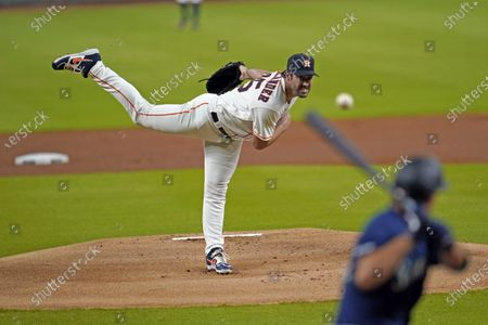 Houston Astros starting pitcher Justin Verlander, left, throws to Seattle Mariners' Evan White during the first inning of a baseball game, in Houston