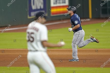 Stock Image of Seattle Mariners' Kyle Seager (15) runs the bases after hitting a home run off Houston Astros starting pitcher Justin Verlander (35) during the fourth inning of a baseball game, in Houston
