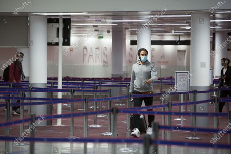 Passenger wearing face mask at Roissy-Charles de Gaulle airport, north of during a visit as sanitary measures have been deployed for departing and arriving passengers in order to curb the spread of the COVID-19 pandemic, caused by the novel coronavirus. Europe hit more than three million coronavirus cases on July 23, while spiking infection numbers worldwide led authorities to reimpose restrictions on citizens.